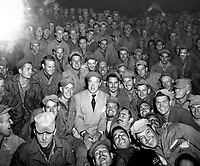 Bob Hope, radio and screen star, sits with men of X Corps, as members of his troupe enterain at Womsan, Korea.  October 26, 1950.  Cpl. Alex Klein.  (Army)<br /> NARA FILE #  111-SC-351586<br /> WAR &amp; CONFLICT BOOK #:  1469