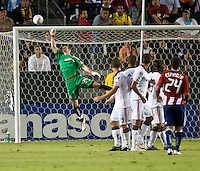 Toronto FC goalie Stefan Frei (24) deflects a Chivas penalty kick from Rodolfo Espinosa (24) over the goal during the first half of the game between Chivas USA and Toronto FC at the Home Depot Center in Carson, CA, on October 9, 2010. Final score Chivas USA 3, Toronto FC 0.