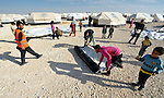 New tents are erected in the Zaatari Refugee Camp, located near Mafraq, Jordan. Opened in July, 2012, the camp holds upwards of 50,000 refugees from the civil war inside Syria, but its numbers are growing. International Orthodox Christian Charities and other members of the ACT Alliance are active in the camp providing essential items and services.