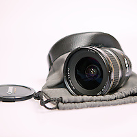 A Canon EF-S 10-22mm lens with pouch and lens cap