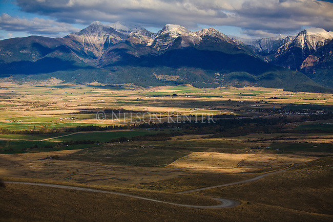 Cloud shadows cross the Mission Valley and Mountains north of Missoula, Montana
