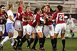 2 November 2005: Maryland teammates congratulate Ashly Kennedy (10) on her 69th minute goal, which made the score 3-1 UNC. The University of North Carolina defeated the University of Maryland 3-1 at SAS Stadium in Cary, North Carolina in the quarterfinals of the 2005 ACC Women's Soccer Championship.