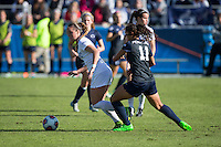 Cary, North Carolina - Sunday December 6, 2015: Ashton Miller (4) of the Duke Blue Devils keeps the ball away from Raquel Rodriguez (11) of the Penn State Nittany Lions during first half action at the 2015 NCAA Women's College Cup at WakeMed Soccer Park.  The Nittany Lions defeated the Blue Devils 1-0.