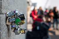 """Love Locks"" are seen attached to various parts of the Brooklyn Bridge in New York on Friday, February 15, 2013. Over the last few years couples around the world have been proclaiming their love during life events such as anniversaries and weddings by attaching locks on bridges and other public spaces. The NYC Dept. of Transportation regularly comes by and clips the locks, which are illegal to attach, making way for new pronouncements of love.   (© Richard B. Levine)"