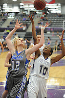 NWA Democrat-Gazette/ANDY SHUPE<br /> Rogers guard Elise Randels (12) and Fayetteville guard Maya Mayberry (10) reach for a rebound Friday, Feb. 10, 2017, during the second half of play in Bulldog Arena. Visit nwadg.com/photos to see more photographs from the game.