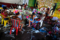 Members of a samba school work on carnival costumes (fantasias) inside the workshop in Rio de Janeiro, Brazil, 15 February 2012. The carnival preparations start early in July or August, some 7-8 months before the main samba schools parade at the sambodrome. Samba schools hire teams of professional designers and artists who, according to the original theme selected by the school directors and then featured by the school during the parade, create allegorical floats, costumes, sculptures, music, choreography and the entire school show. However, the most of the everyday work in the carnival hangars is performed by unknown but fully dedicated samba schools members.