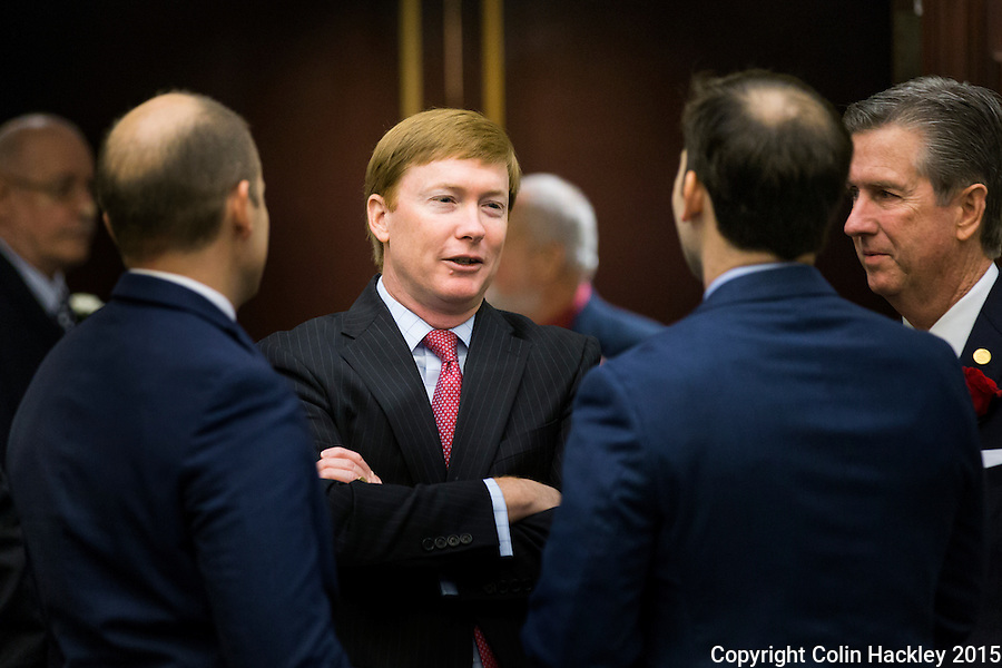 TALLAHASSEE, FLA. 1/12/16-Agriculture Commissioner Adam Putnam, center, talks with Rep. Jim Boyd, R-Bradenton, right and others prior to the State of the State address at the Capitol in Tallahassee.<br /> <br /> COLIN HACKLEY PHOTO