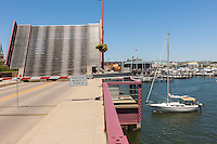 The Spa Creek drawbridge is raised to allow tall masted sailboats to pass in Annapolis, Maryland.