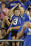 A boy celebrates a UK touchdown during the first half of UK's home game against Akron, Saturday, September 17, 2010.  Photo by Brandon Goodwin | Staff