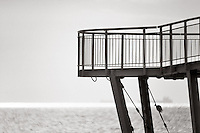 A close up view of a pier at the beach of Lido in Venice, Italy