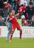 Sporting KC defender Aurelien Collin #78 and Toronto FC forward Maicon Santos #29 in action during an MLS game between Sporting Kansas City and the Toronto FC at BMO Field in Toronto on June 4, 2011..The game ended in a 0-0 draw...