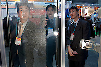 Visitors look at a transparent solar cell, PV Expo 2009, Tokyo International Exhibition Center, Tokyo, 26 February 2009.