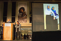 Images of Yusor Abu-Salha, 21 (left on screen) are projected as friends speak to thousands who gathered for a vigil and memorial for three shooting victims at The Pit at The University of North Carolina at Chapel Hill in Chapel Hill, North Carolina on Wednesday, February 11, 2015. Craig Hicks, 46, of Chapel Hill has been charged with three counts of first-degree murder in the killings of Deah Barakat, 23, a UNC student; his wife, Yusor Abu-Salha, 21; and her sister, Razan Abu-Salha, 19. (Justin Cook)