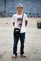 Gukeerguo, a student, age 22, poses for a portrait in Beijing. Response to 'What does China mean to you?': 'Home country.'  Response to 'What is your role in China's future?': 'I don't know.'