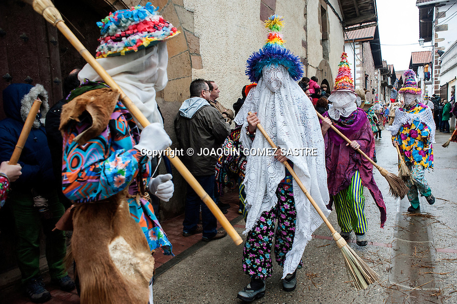 Participants in the Carnival of Lantz in Navarra broom through the streets giving people the assistant public.