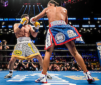 """NEW YORK, NY - MARCH 04: Undefeated WBA Welterweight Champion Keith """"One Time"""" Thurman during the bout with Undefeated WBC Welterweight Champion Danny """"Swift"""" Garcia, for the unified belt, at Barclays Center on March 4, 2017 in the borough of Brooklyn, New York City.. (Photo by Douglas DeFelice/Eclipse Sportswire/Getty Images)"""