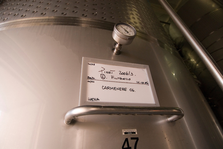 Chile Wine Country: Stainless steel tank at Undurraga Winery, Vina Undurraga, with special Chilean varietal Carmenere..Photo #: ch432-33910.Photo copyright Lee Foster, 510-549-2202, www.fostertravel.com, lee@fostertravel.com.