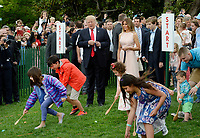 United States President Donald Trump , First Lady Melania Trump and son Barron watch the start an egg roll during the annual Easter Egg Roll on the South Lawn of the White House  in Washington, DC, on April 17, 2017. <br /> CAP/MPI/CNP/RS<br /> &copy;RS/CNP/MPI/Capital Pictures
