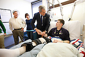 Washington, DC - December 22, 2008 -- United States President George W. Bush shakes hands with United States Army Staff Sergeant Kyle Stipp of Avon, Indiana, after presenting him with two Purple Hearts Monday, December 22, 2008, during a visit to Walter Reed Army Medical Center where the soldier is recovering from wounds suffered in Operation Iraqi Freedom. Looking on are his wife, Megan, and father, Mitch Stipp. .Credit: Eric Draper - White House via CNP