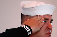 PUNTA GORDA, FL -- March 13, 2008 -- Navy Petty Officer 2nd Class Justin Hall cries as he salutes his brother during a gunshot salute during a memorial service for former Marine Eric Hall at the Faith Lutheran Church in Punta Gorda, Fla., on Thursday, March 13, 2008.  Hall went missing on Feb. 3 after having a flashback to his time in Iraq, and was found dead weeks later by the Vietnam veteran volunteers in a culvert.
