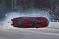 Mar. 9, 2012; Gainesville, FL, USA; NHRA pro mod driver Mike Janis crashes during qualifying for the Gatornationals at Auto Plus Raceway at Gainesville. Janis would be unhurt in the incident. Mandatory Credit: Mark J. Rebilas-