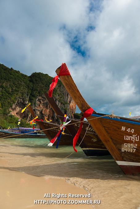 Longtail boats on Phra Nang Beach near Railay in Krabi, Thailand