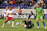 Seattle Sounders goalkeeper Kasey Keller (18) reaches out to deny Thierry Henry (14) of the New York Red Bulls the ball during the first half during a Major League Soccer (MLS) match at Red Bull Arena in Harrison, NJ, on March 19, 2011.