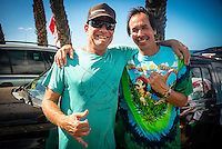 North Shore, Oahu, Hawaii (Sunday, Dec. 1, 2013) .TJeff Bushman (HAW) with Mark Liddell (HAW). -- Hawaii's own Ezekiel Lau, 20, posted the largest victory of his young career today by winning the prestigious 39th annual VANS World Cup of Surfing at Sunset Beach - the second stop of the Vans Triple Crown of Surfing. Lau's win earned him $40,000 and sees him close the year at 35th position on the ASP world rankings. While that doesn't qualify him for next year's elite World Championship Tour, it does guarantee him an excellent seed. He also holds a shared lead on the coveted Vans Triple Crown series rankings with Michel Bourez (PYF) heading into the third and final event of the series - the Billabong Pipe Masters, where he is a local wildard entry.<br /> <br /> Lau made a late tube-riding charge from behind to turn the tables on Damien Hobgood (USA) and Raoni Monteiro (BRA) in the latter half of the 30-minute final. Fourth place was Frederico Morais, (PRT), who was announced the JN Chevrolet Rookie of the 2013 Vans Triple Crown. Lau went on the hunt and found his way onto the biggest waves of the final that also offered high-scoring tube riding potential. His final scoreline was 15.5 points out of 20 (8.67 and 6.83 point rides). Hobgood was second on 14.3; Monteiro third with 12.33, and Morais on 7.16.Photo: joliphotos.com