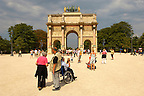 Tourists one in a wheelchair in the Jardin des Tuileries -Arch - Paris - France