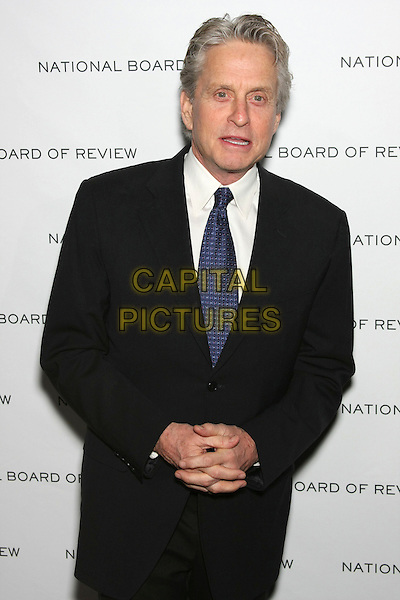 MICHAEL DOUGLAS .National Board of Review of Motion Picture Awards Gala held at Cipriani 42nd Street, New York, NY, USA, .12th January 2010. .half length black suit  blue tie .CAP/LNC/TOM.©LNC/Capital Pictures.