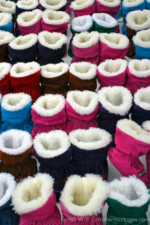 Europe, Scandinavia, Finland, Helsinki. Winter booties in a variety of colors for sale in the Helsinki market.