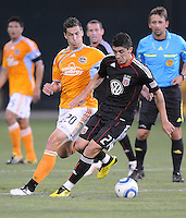DC United forward Pablo Hernandez (21) shields the ball against Houston Dynamo midfielder Geoff Cameron (20)   The Houston Dynamo defeated DC United 3-1, at RFK Stadium, Saturday September 25, 2010.