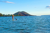 Young woman standup paddle boarding at Makena, Maui