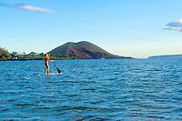 Young woman standup paddling at Makena, Maui