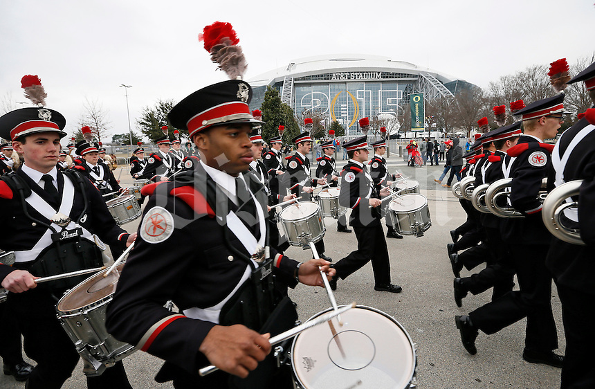 The Ohio State Marching Band walks past AT&T Stadium prior to the College Football Playoff National Championship against the Oregon Ducks in Arlington, Texas on Jan. 12, 2015. (Adam Cairns / The Columbus Dispatch)