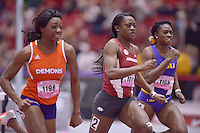 NWA Democrat-Gazette/BEN GOFF @NWABENGOFF<br /> Daeshon Gordon (from left) of Northwestern, Kelsey Herman of Arkansas and Brittany Kelly of LSU run in the 60 meter hurdles prelims Friday, Feb. 10, 2017 during the Tyson Invitational at the Randal Tyson Track Complex in Fayetteville.