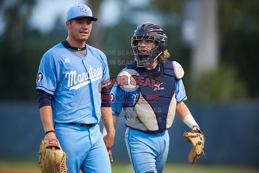 SCF Manatees starting pitcher Brendon Little (15) and catcher Reilly Johnson (19) walk to the dugout during a game against the College of Central Florida Patriots on February 8, 2017 at Robert C. Wynn Field in Bradenton, Florida.  SCF defeated Central Florida 6-5 in eleven innings.  (Mike Janes/Four Seam Images)