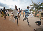 Desperate refugees, tired of waiting in lines, rush into a World Food Program compound in the Dadaab refugee camp in northeastern Kenya. Tens of thousands of newly arrived Somalis who have swelled the population of what was already the world's largest refugee camp.