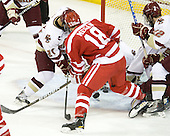 Steven Whitney (BC - 21), Wade Megan (BU - 18), John Muse (BC - 1), Paul Carey (BC - 22) - The Boston College Eagles defeated the visiting Boston University Terriers 5-2 on Saturday, December 4, 2010, at Conte Forum in Chestnut Hill, Massachusetts.