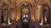 North transept, seen from the gallery, in the Abbatiale Sainte-Foy de Conques or Abbey-church of Saint-Foy, Conques, Aveyron, Midi-Pyrenees, France, a Romanesque abbey church begun 1050 under abbot Odolric to house the remains of St Foy, a 4th century female martyr. The stained glass windows were made by Pierre Soulages in 1987-94, in colourless, translucent glass. The church is on the pilgrimage route to Santiago da Compostela, and is listed as a historic monument and a UNESCO World Heritage Site. Picture by Manuel Cohen