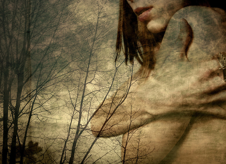 Montage of a naked young woman with crossed arms against a rural winter scene with trees