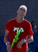 NEW YORK, NY AUG 27: American tennis player Sam Querrey reacts as he plays at the new Grandstand stadium during a day of practice at the USTA Billie Jean King National Tennis Center in Flushing Meadows, on August 27, 2016 in New York City. (Photo by VIEWpress)
