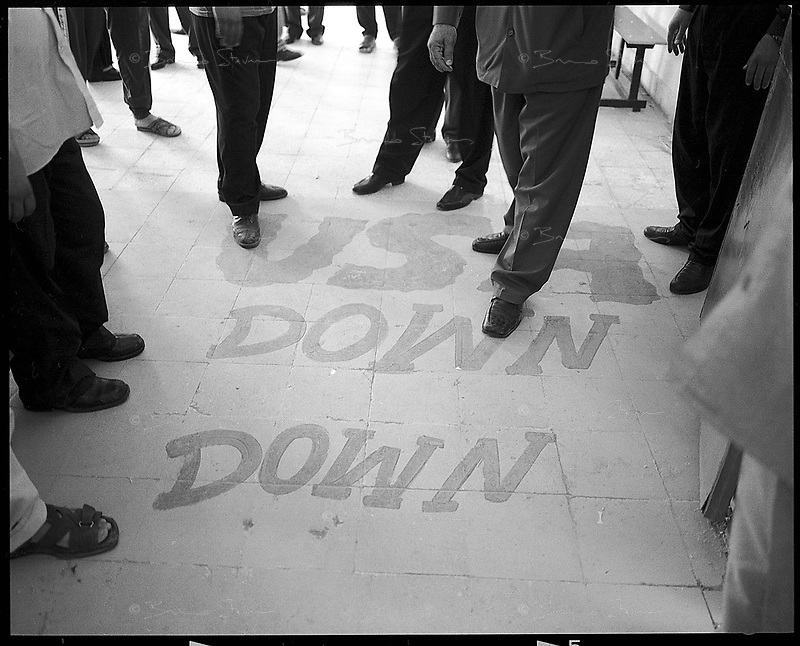Tikrit, Iraq; October 15th, 2002.Anti-US slogan painted on the ground of a school used as a polling station during the referendum to extend Saddam Hussein's presidential mandate for 7 years, the turnout appeared to be massive as well as the enthusiasm of the Iraqis to support their president..Tikrit is the birthplace city of Saddam Hussein.