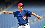 22 April 2010: Washington Nationals' coach Tim Foli tosses batting practice prior to a game against the Colorado Rockies at Nationals Park in Washington, DC. The Nationals were shut out by the Rockies 2-0 closing out their series with a 2-2 game split. Mandatory Credit: Ed Wolfstein Photo