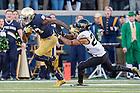 Nov. 14, 2015; Running back Josh Adams (33) breaks free of Wake Forest Demon Deacons safety Ryan Janvion (22) for a 98 yard touchdown run in the second quarter. Notre Dame won 28-7. (Photo by Matt Cashore)