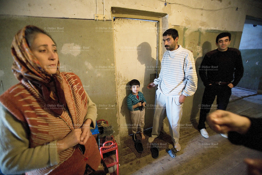 Azerbaijan. Ganja region. Ganja. Muslim women, men and a child from Nagorno-Karabagh. The woman wears a scarf on her head to cover the hair. The persons are all Internally displaced persons (IDPs). They were forced to flee their homes in 1993, but remained within their country's borders. © 2007 Didier Ruef