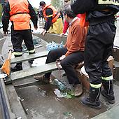 BORKI, POLAND, MAY 24, 2010:.Rescue workers evacuating villager ..The latest chapter of disastrous floods in Poland has been opened yesterday, May 23, 2010, after Vistula river broke its banks and flooded over 25 villages causing evacualtion of most inhabitants..Photo by Piotr Malecki / Napo Images..BORKI, POLSKA, 24/05/2010:.Ewakuacja mieszkanca wsi. Najnowszy akt straszliwych tegorocznych powodzi zostal rozpoczety wczoraj gdy Wisla przerwala waly na wysokosci wsi Swiniary kolo Plocka..Fot: Piotr Malecki / Napo Images ..