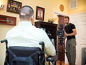 Afganistan war vet Josh Himan during filing of a video segment at his family's home in Woodbridge, VA.
