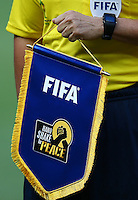The referee holds the FIFA 'Handshake for peace' pennant