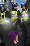 Stop the City march and demonstration against capitalism April1st City of London while G20 World Leaders Summit meet in London. 2009. Punk woman and police.